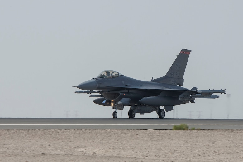 A U.S. Air Force F-16 Fighting Falcon assigned to the 480th Fighter Squadron taxis on the flightline upon arrival at Al Dhafra Air Base, United Arab Emirates, Nov. 12, 2020.