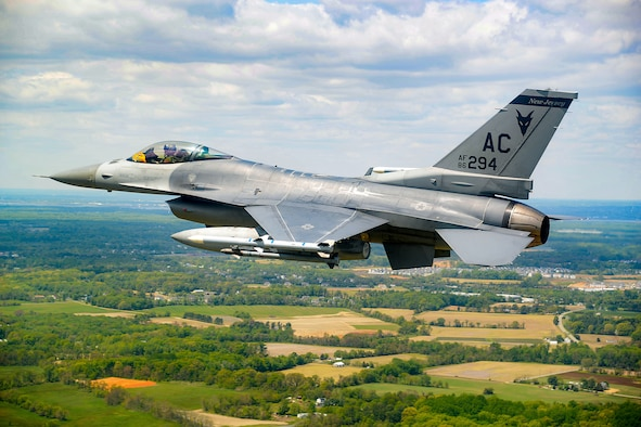 An image of a New Jersey Air National Guard F-16 Fighting Falcon flying.
