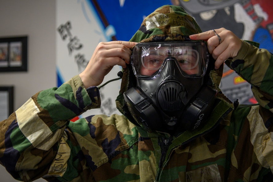 U.S. Air Force Airman 1st Class Tiffany Eustice, a 35th Civil Engineer Squadron emergency manager, puts on mission oriented protective posture gear at Misawa Air Base, Japan, Nov. 12, 2020. Airmen are exposed to high heat stress environments while in MOPP gear and this vest worn underneath the gear allows for constant cooling of the Airmen's core temperature. In response to the MOPP gear areas of improvement, RINI Technologies, a company that provides innovative solutions to thermal-management challenges out of Florida, submitted a proposal for a MOPP cooling system that cools down the vest while being worn. (U.S. Air Force photo by Airman 1st Class China M. Shock)