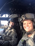 West Virginia National Guard Chief Warrant Officer 3 Allison Dunfee, who currently serves as an C-12 pilot with Detachment 28, Operational Support Airlift Activity (OSA-A) in Williamstown, West Virginia, poses with her husband Chief Warrant Officer 3 Casey Dunfee. A 13-year member of the Guard, Dunfee was selected as the WVNG Chief Warrant Officer spotlight for the month of November 2020. (Courtesy photo provided.)