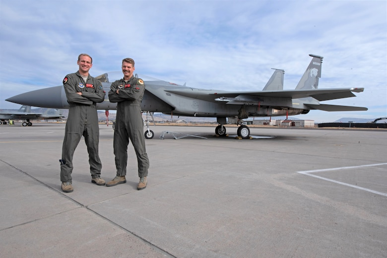 U.S. Air Force Capt. Jasper (left) and 1st Lt. David Arneberg are brothers who for the first time in 173rd Fighter Wing history are navigating the F-15C B-Course together, Nov. 12, 2020 at Kingsley Field in Klamath Falls, Oregon. Although both completed Undergraduate Pilot Training and Introduction to Fighter Fundamentals in separate locations, their paths converged when both tracked to F-15C aircraft at the sole schoolhouse for the Eagle in the U.S. Air Force. (U.S. Air National Guard photo by Master Sgt. Jefferson Thompson)