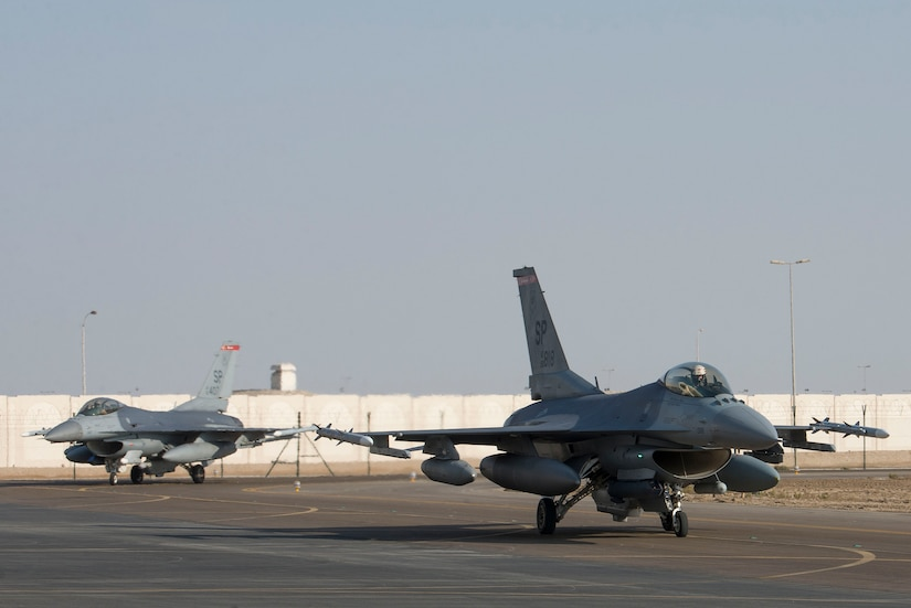Two U.S. Air Force F-16 Fighting Falcons assigned to the 480th Fighter Squadron, 52nd Fighter Wing, Spangdahlem Air Base, Germany, taxi on the flightline upon arrival at Al Dhafra Air Base, United Arab Emirates, Nov. 12, 2020. Deploying as an instrument of Dynamic Force Employment, the contingent of F-16s and support personnel will rapidly integrate into theater air training, as well as joint, coalition and partnered missions in support of U.S. Air Forces Central and U.S. Central Command priorities. The dynamic deployment highlights the Air Force's ability to rapidly deploy and employ forces anywhere around the globe at any moment. (U.S. Air Force photo by Staff Sgt. Zade Vadnais)