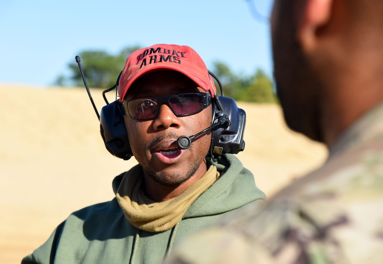 U.S. Air Force Staff Sgt. Kendrick Jones, 87th Security Forces Squadron combat arms instructor, instructs an Airman during the M4 rifle qualification course at the U.S. Army Support Activity training range, Nov. 6, 2020, on Joint Base McGuire-Dix-Lakehurst, N.J. This qualification course will prepare Airmen for deployment operations in the future. (U.S. Air Force photo by Daniel Barney)