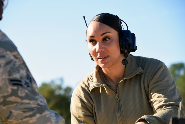 U.S. Air Force Staff Sgt. Tynisia Hains, 87th Security Forces Squadron combat arms instructor, provides feedback to an Airman during the M4 rifle qualification course at the U.S. Army Support Activity training range, Nov. 6, 2020, on Joint Base McGuire-Dix-Lakehurst, N.J. This qualification course will prepare Airmen for deployment in the future. (U.S. Air Force photo by Daniel Barney)