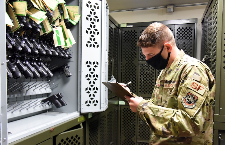 U.S. Air Force Staff Sgt. Andrew Barrows, 87th Security Forces Squadron combat arms instructor, performs inventory checks in the armory room, Nov. 6, 2020, on Joint Base McGuire-Dix-Lakehurst, N.J. Barrows performs inventory checks on a daily basis to ensure that all weapons and ammunition are accounted for, while maintaining smooth operations. (U.S. Air Force photo by Daniel Barney)