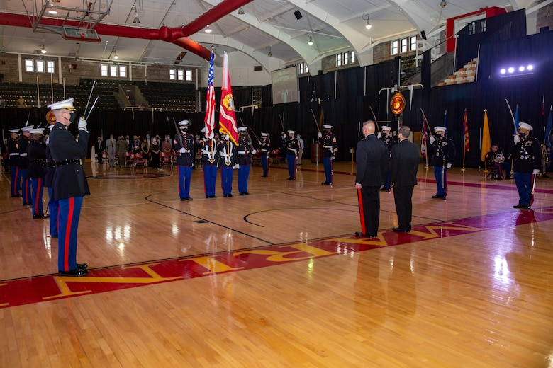 U.S. Marines present the colors during the Marine Corps Installations East-Marine Corps Base Camp Lejeune cake cutting ceremony at the Goettge Memorial Field House on MCB Camp Lejeune, North Carolina, Nov. 10, 2020. Marines with MCIEAST-MCB Camp Lejeune celebrated the 245th Marine Corps birthday by reading Gen. John A. Lejeune's, 13th Commandant of the Marine Corps, birthday message and the cutting of the traditional birthday cake while adhering to COVID-19 mitigation protocols. (U.S. Marine Corps photo by Lance Cpl. Christian Ayers)