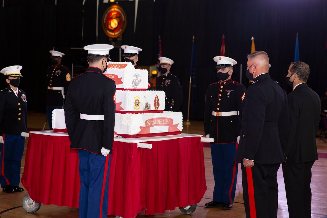 U.S. Marines prepare for the official cake cutting during the Marine Corps Installations East-Marine Corps Base Camp Lejeune cake cutting ceremony at the Goettge Memorial Field House on MCB Camp Lejeune, North Carolina, Nov. 10, 2020. Marines with MCIEAST-MCB Camp Lejeune celebrated the 245th Marine Corps birthday by reading the birthday message from Gen. John A. Lejeune, 13th Commandant of the Marine Corps and cutting the traditional birthday cake while adhering to COVID-19 mitigation protocols. (U.S. Marine Corps photo by Lance Cpl. Christian Ayers)