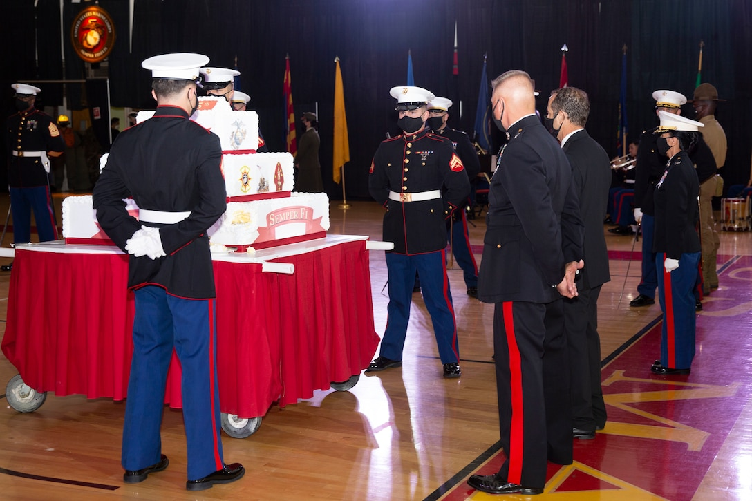 U.S. Marines prepare for the march off of the traditional cake during the Marine Corps Installations East-Marine Corps Base Camp Lejeune cake cutting ceremony, at the Goettge Memorial Field House on MCB Camp Lejeune, North Carolina, Nov. 10, 2020. Marines with MCIEAST-MCB Camp Lejeune celebrated the 245th Marine Corps birthday by reading the birthday message from Gen. John A. Lejeune, 13th Commandant of the Marine Corps and cutting the traditional birthday cake while adhering to COVID-19 mitigation protocols. (U.S. Marine Corps photo by Lance Cpl. Christian Ayers)