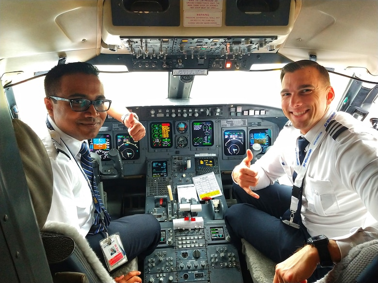 Airman 1st Class Sorav Basu Roy (left), an air transportation specialist assigned to the 482nd Fighter Wing, Homestead Air Reserve Base, Florida, and a commercial airline pilot with United Express, is living the American dream.
