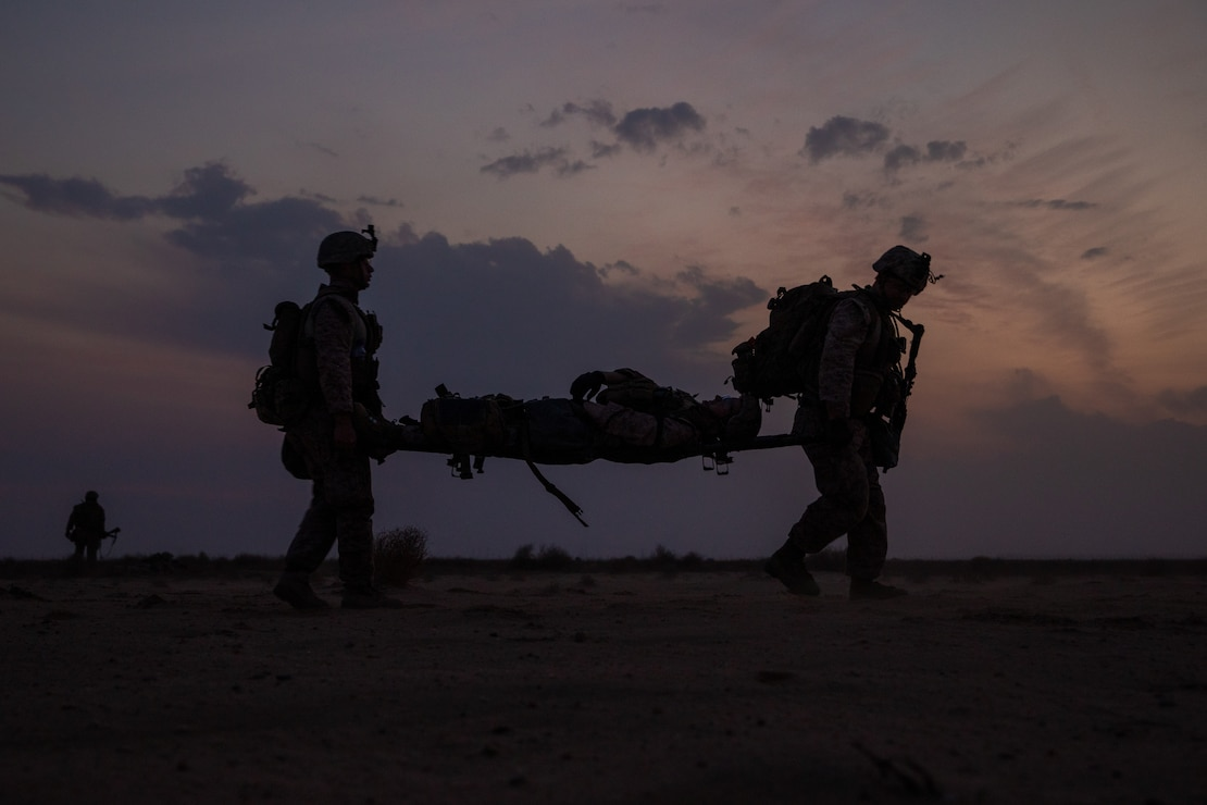 A U.S. Marine and U.S. Navy Corpsmen evacuate a simulated casualty during a Tactical Recovery of Aircraft and Personnel exercise in Kuwait, Nov. 11.