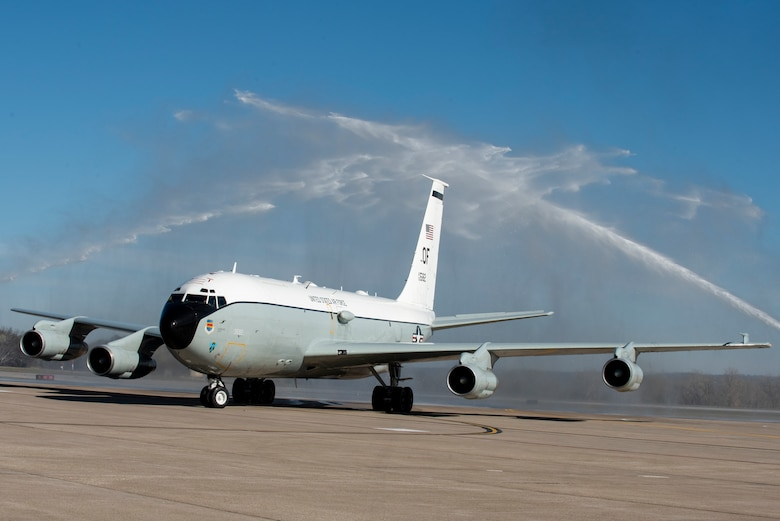 WC-135 Constant Phoenix tail number 582 is sprayed by fire trucks