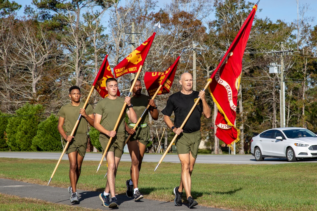 U.S. Marine Corps Master Gunnery Sgt. Robert K. Herrron, right, the maintenance chief for Center for Naval Aviation Technical Training (CNATT), leads Pfc. Ethan E. Cole, left, Pfc. Eric J. Fonseca, center left, and Pfc. Chris J. Traylor, center right, all students with CNATT, in a run to commemorate the Marine Corps Birthday on Marine Corps Air Station New River, North Carolina, Nov. 10, 2020. Marines on MCAS New River ran in teams for at least one mile to reach a total of 245 miles in honor of the 245th Marine Corps Birthday. (U.S. Marine Corps Photo by Lance Cpl. Isaiah Gomez)