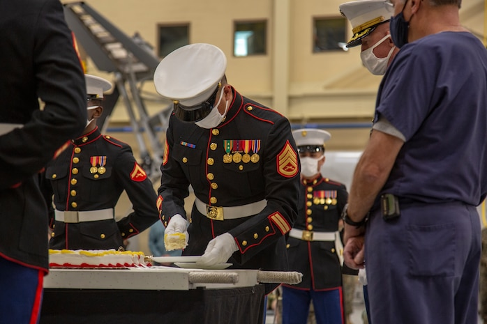 U.S. Marines with the Center for Naval Aviation Technical Training (CNATT) cut the cake at the 245th Marine Corps birthday cake cutting ceremony on Marine Corps Air Station New River, North Carolina, Nov. 10, 2020. A celebration for the Marine Corps birthday is held every year to reflect on the traditions, history and legacy of the Marine Corps. Due to COVID-19, this year's celebration was held with increased regulations and safety precautions. (U.S. Marine Corps Photo by Lance Cpl. Isaiah Gomez)