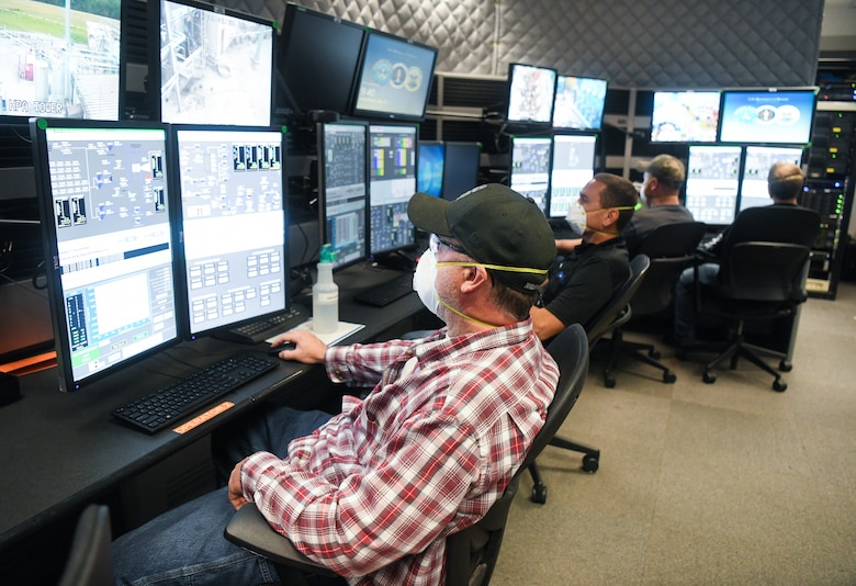 John VanScoten, left, an outside machinist, Daryl Osteen, a test operations engineer, and other Team AEDC personnel work in the control room of the Arnold Engineering Development Complex Aerodynamic and Propulsion Test Unit (APTU), May 20, 2020, while wearing masks to help mitigate risk associated with the coronavirus pandemic. The APTU team has performed their tasks, providing hypersonic testing capabilities, without interruption during the pandemic. Hypersonics is considered a critical field for national defense. (U.S. Air Force photo by Jill Pickett)