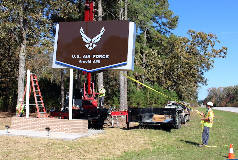 The new sign at the Main Gate at Arnold Air Force Base, Tenn., is installed Oct. 22, 2020. Located alongside Wattendorf Highway before entering the base, the new sign was necessary after an accident occurred in February 2020, in which a car ran off the roadway and collided with the previous sign. The project was completed by the Simplified Acquisition Base Engineering Requirements (SABER) contractor, SDVE, LLC. (U.S. Air Force photo by Deidre Moon)