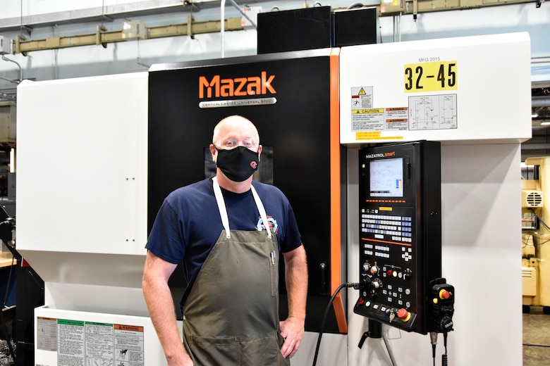 """Daniel Jones, inside machinist lead at the Arnold Engineering Development Complex Model and Machine Shop at Arnold Air Force Base, Tenn., competes in drag racing and builds racers in his free time. Jones, who refers to himself as a """"gearhead,"""" took up drag racing as a hobby around 25 years ago. (U.S. Air Force photo by Bradley Hicks)"""
