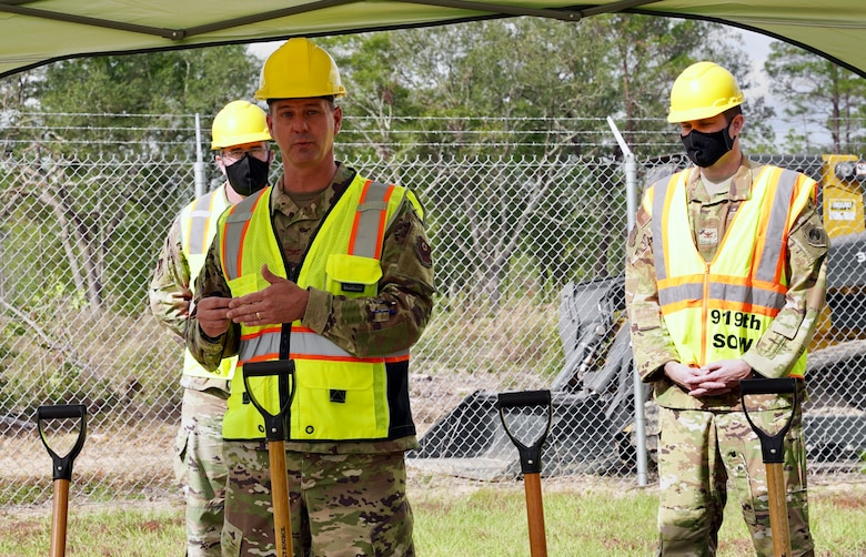 Photo of 492 SOW commander speaking during a ground breaking ceremony