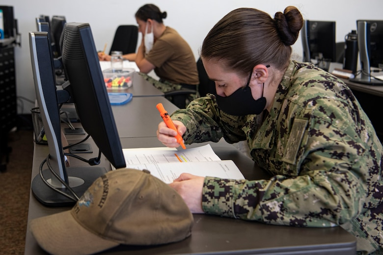 Photo of a sailor highlighting information.