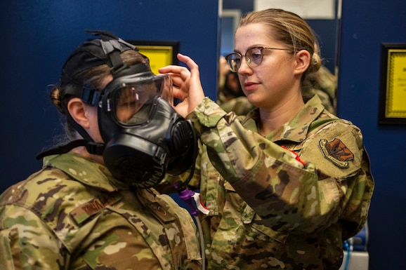 Senior Airman Jessica Jergenson, 188 Med Group member, performs a mask fit test on an M-50 Joint Service General Purpose (gas) Mask at Fort Smith, Ark., Oct. 10, 2020.