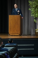 U.S. Air Force Col. Matthew Leard, 97th Air Mobility Wing commander, speaks to the Specialized Undergraduate Pilot Training class of 21-02 during their graduation ceremony Nov. 13, 2020, on Columbus Air Force Base, Miss. As commander, Leard is responsible for the formal training of all KC-46 Pegasus, C-17 Globemaster III and KC-135 Stratotanker aircrews for active duty, Air National Guard and Air Force Reserve units, as well as multiple partner air forces from across the world. (U.S. Air Force photo by Senior Airman Jake Jacobsen)