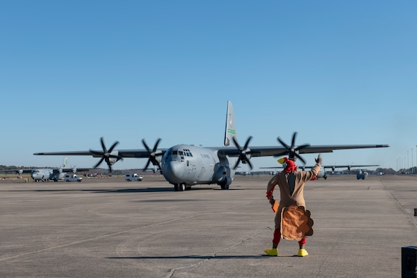 Man in Turkey suit marshals out a C-130J