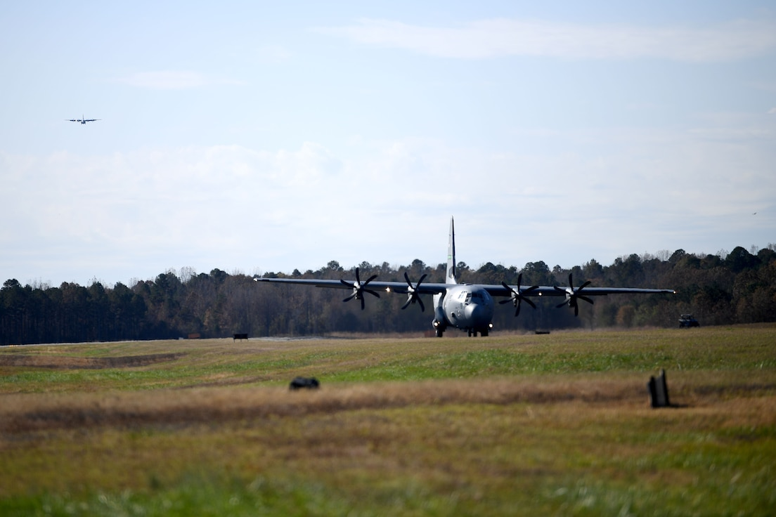 A C-130J lands on makeshift runway