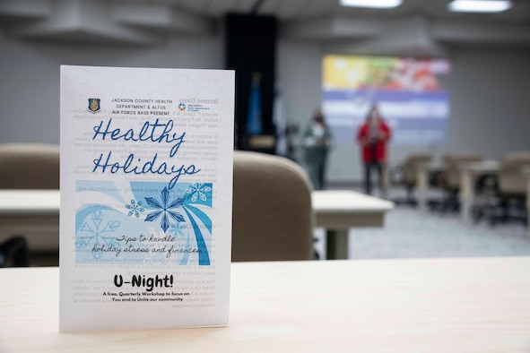 a pamphlet reading j=healthy holidays sits on a table