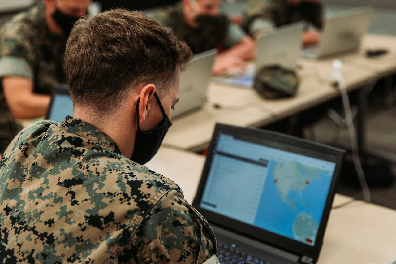 Marines use laptops.