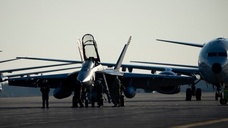 Personnel prepare an EA-18 Growler for takeoff during a Bomber Task Force mission at Misawa Air Base, Japan, Nov. 13, 2020. Bomber Task Force missions demonstrate U.S. commitment to allies and partners throughout the Indo-Pacific area of responsibility and the ability of Air Force Global Strike Command to deliver lethal strike options for combatant commanders at a moment's notice. (U.S. Air Force photo by Staff Sgt. Grace Nichols)