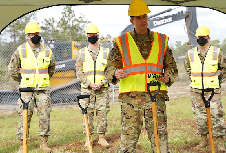 Photo of 919 SOW commander standing next to a shovel while speaking