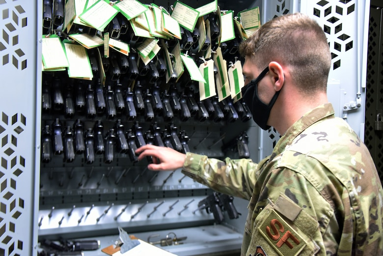 U.S. Air Force Staff Sgt. Andrew Barrows, 87th Security Forces Squadron combat arms instructor, performs a M9 weapons inventory check in the armory, Nov. 6, 2020, on Joint Base McGuire-Dix-Lakehurst, N.J. Barrows performs inventory checks on a daily basis to ensure that all weapons and ammunition are accounted for, and helps the 87 SFS maintain smooth operations. (U.S. Air Force photo by Daniel Barney)