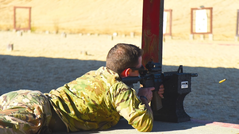 A participant in the M4 qualification course fires his M4 rifle at the U.S. Army Support Activity training range, Nov. 6, 2020, on Joint Base McGuire-Dix-Lakehurst, N.J. This qualification course will prepare Airmen for deployment operations in the future. (U.S. Air Force photo by Daniel Barney)