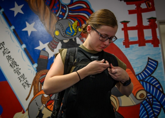 U.S. Air Force Airman 1st Class Tiffany Eustice, a 35th Civil Engineer Squadron emergency manager, puts on the cooling vest at Misawa Air Base, Japan, Nov. 12, 2020. Airmen are potentially exposed to high heat-stress environments and the vest allows for constant cooling of the Airmen's core temperatures ensuring Airmen can safely execute the mission. (U.S. Air Force photo by Airman 1st Class China M. Shock)