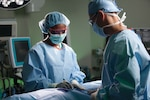 Surgeons perform a procedure at Brooke Army Medical Center, Joint Base San Antonio-Fort Sam Houston, Texas.