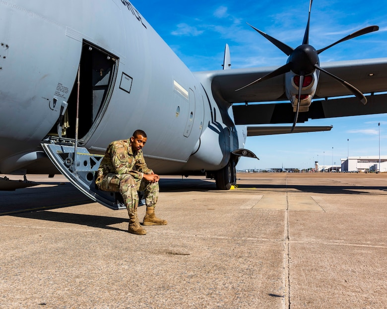 Air Force Reserve Senior Amn Edward Hunter, 913th Maintenance crew chief, poses on the steps of a C-130J Super Hercules at Little Rock Air Force Base, Ark, Nov. 4, 2020. Most recently, Hunter volunteered to help the Hurricane Hunters based out of Kessler AFB, Mississippi, to ensure that the aircraft were ready to fly at a moment's notice carry out the numerous National Oceanic and Atmospheric Administration missions this season.
