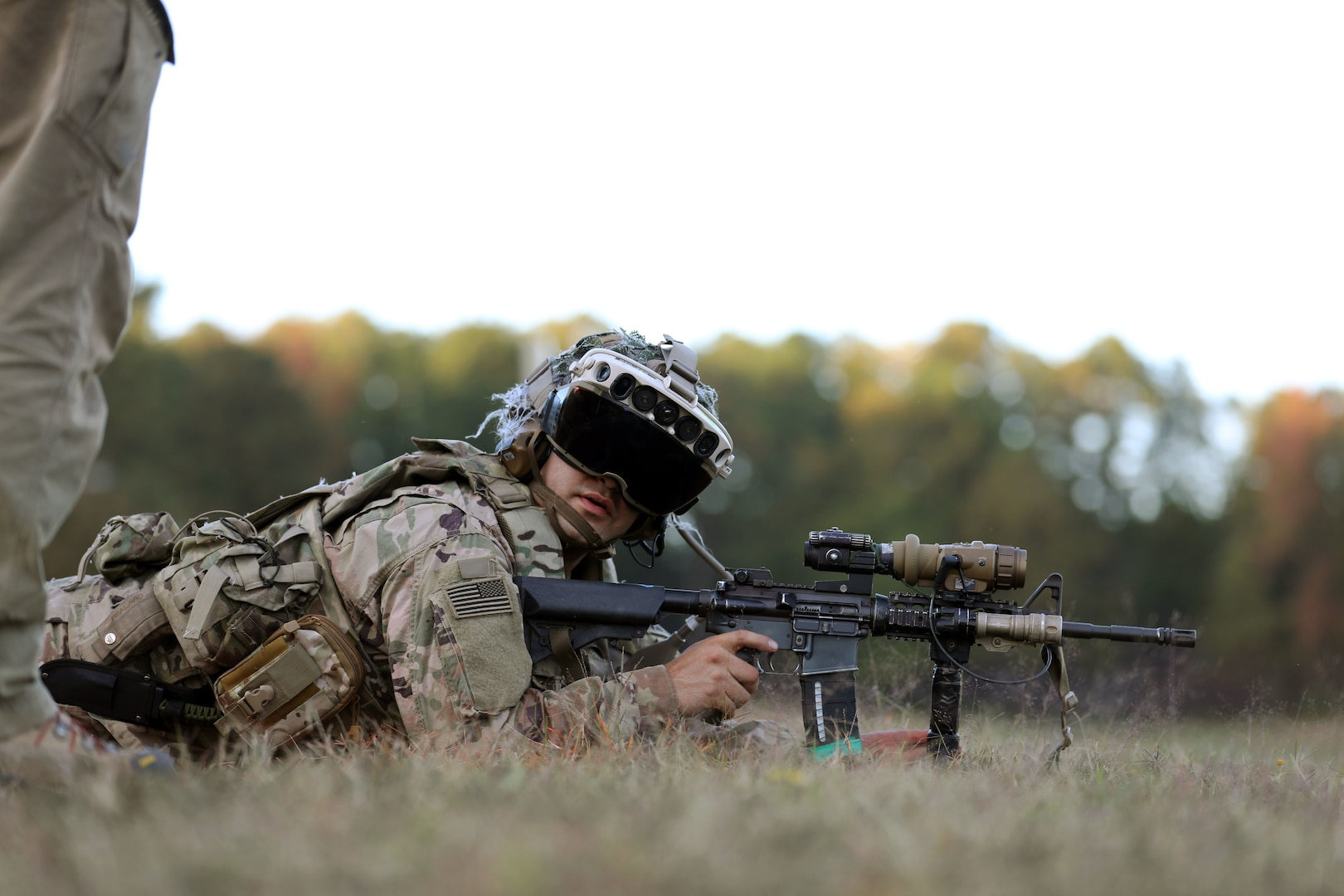 Soldier tests the Capability Set 3 (CS3) militarized form factor prototype of the Army's Integrated Visual Augmentation System (IVAS) during a life fire test event at its third Soldier Touchpoint (STP 3) at Fort Pickett, Virginia.