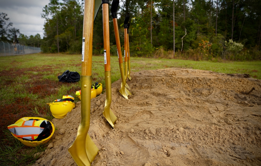 Photo of shovels standing in a mound of dirt