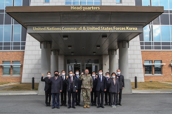 "Gen. Robert B. ""Abe"" Abrams and members of South Korea's National Assembly Defense Committee pose in front of UNC and USFK Headquarters."