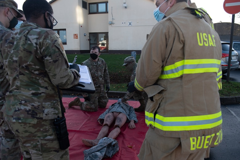 U.S. Air Force Airmen respond to a casualty during an active shooter exercise at Spangdahlem Air Base, Germany, Nov. 16, 2020. The exercise tested the ability of different base agencies' response times during an emergency situation, and allowed for evaluations to be performed by Wing Inspection Teams. (U.S. Air Force photo by Senior Airman Ali Stewart)