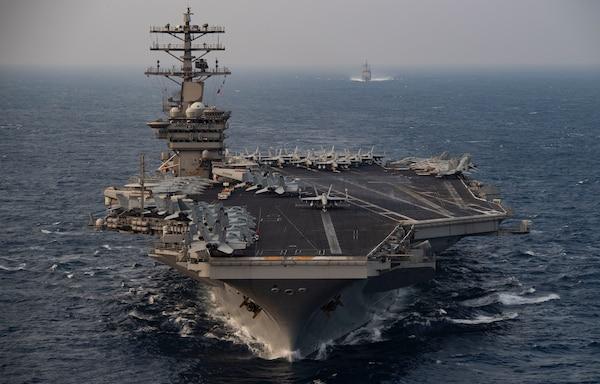 USS Nimitz (CVN 68) steams ahead of USS Princeton (CG 59) while participating in Malabar 2020 in the north Arabian Sea.