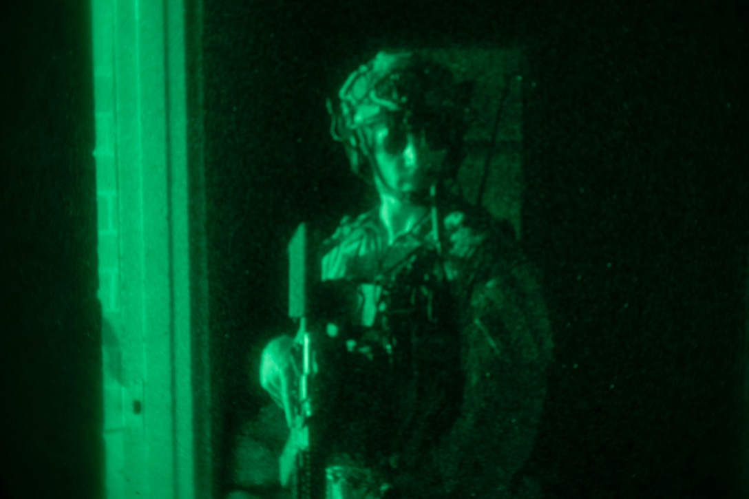 A U.S. Marine executes a direct-action night raid during Training Exercise II at Marine Corps Base Camp Lejeune, N.C., July 26.