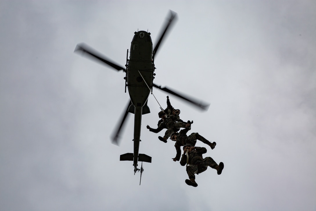 U.S. Marines conduct special patrol insertion/extraction and helicopter rappel training at Camp Hansen, Okinawa, Japan, Oct. 23.