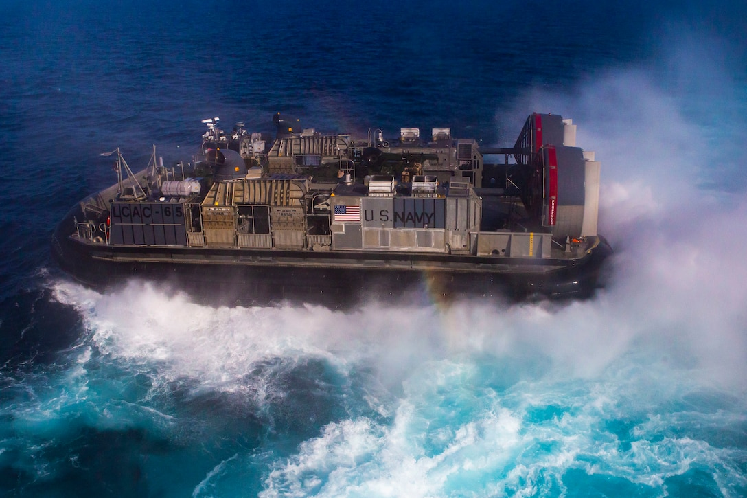 U.S. Sailors pilot Landing Craft, Air Cushion 6 while transporting Marines in support of a forward arming and refueling point operation, Oct. 12.