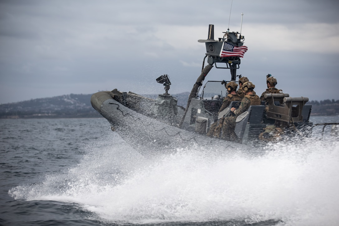 U.S. Marines maneuver an 11M naval special warfare rigid-hull inflatable boat through the ocean during a small boat training event, Oct. 24.