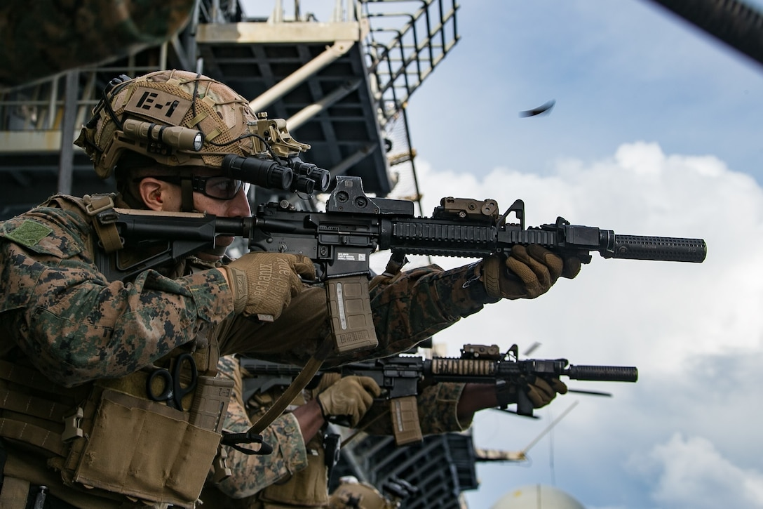 A U.S. Marine fires a M27 Infantry Automatic Rifle during a live fire exercise aboard amphibious assault ship USS America (LHA 6), Oct. 3.