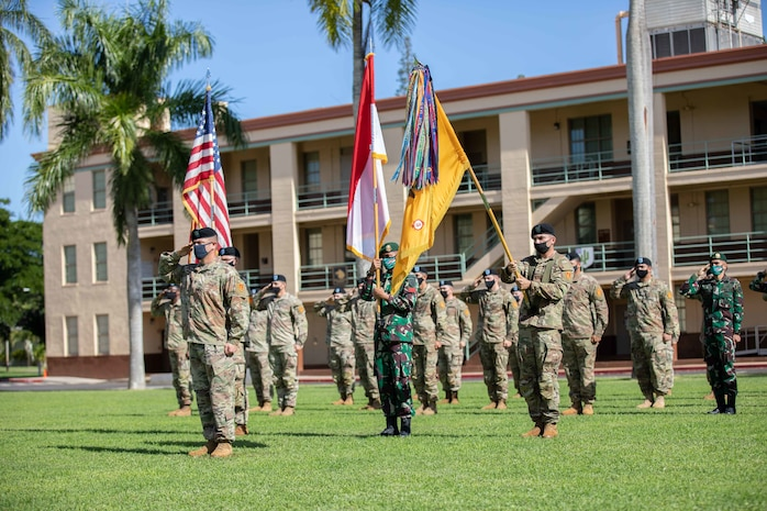 Soldiers assigned to 3rd Squadron, 4th Cavalry Regiment, 3rd Infantry Brigade Combat Team, 25th Infantry Division and Soldiers assigned to the Indonesian Army's 431st Para Raider Infantry Battalion render hand salutes during the playing of the national anthems of the United States and Indonesia during the opening ceremony of the U.S. hosted portion of the 2020 Indonesia Platoon Exchange at Schofield Barracks, Hawaii on Nov. 14, 2020. Throughout the next two weeks, Soldier from both armies will train alongside one another sharing their expertise in tactics to include counter-improvised explosive device training, Military Operations in Urban Terrain (MOUT) training and survival training at the 25th Infantry Division's Lightning Academy. (U.S. Army photo by Staff Sgt. Alan Brutus)