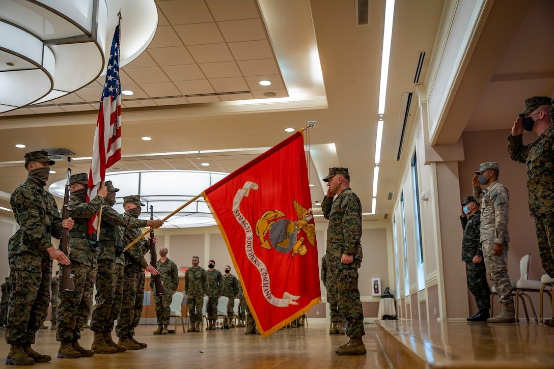 Col. Vincent Dawson salutes the unit colors during the SPMAGTF-SC closing ceremony at Camp Lejeune, N.C., Nov. 13.
