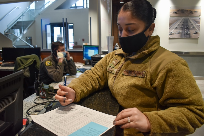 A photo of Airman Ashley Arbelo, a Squadron Aviation Resource Manager, working at the operations desk while pilots are flying sorties at Hill Air Force Base, Utah.