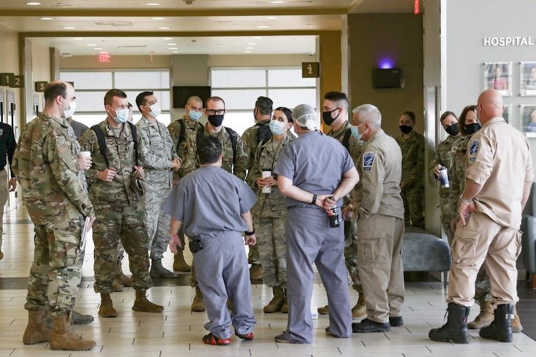 U. S. Air Force medical personnel are welcomed to the Hospitals of Providence Transmountain in El Paso, Texas, Nov. 8, 2020 by departing medical personnel of the National Disaster Medical System. U.S. Northern Command, through U.S. Army North, remains committed to providing flexible Department of Defense support to the Federal Emergency Management Agency in support of the whole-of-nation COVID-19 response. (U.S. Army photo by Sgt. Samantha Hall)