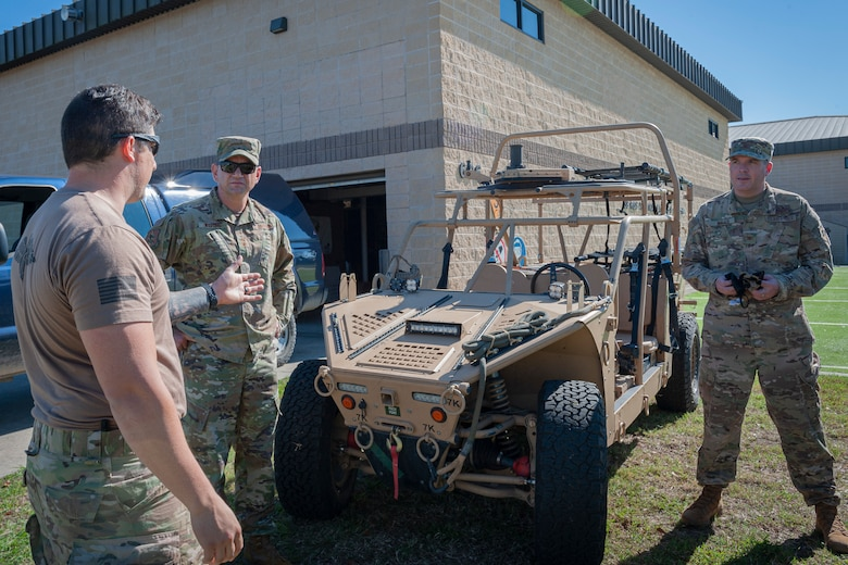 Photo of an Airman explaining storm search and rescue vehicle features